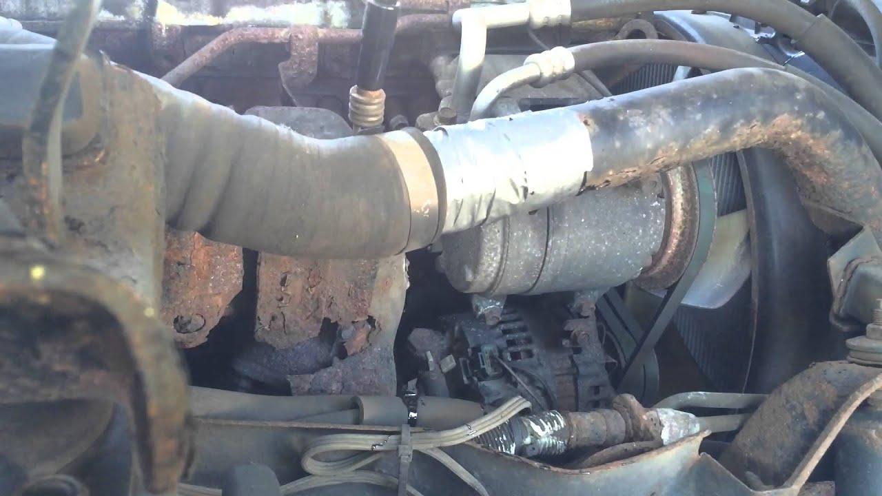 roadside repair of turbo line on a 2006 isuzu npr box truck [ 1280 x 720 Pixel ]