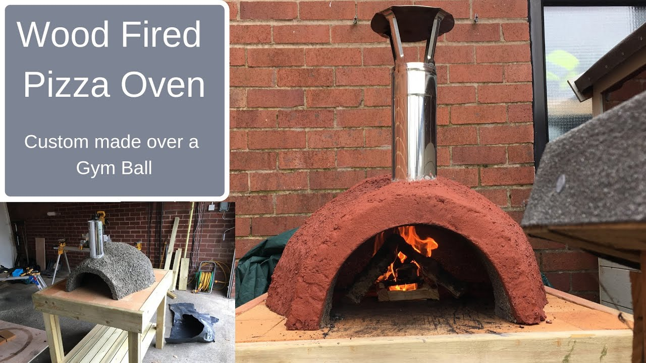 wood fired pizza oven made over a gym ball using vermiculite and