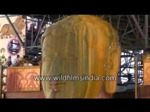 Haldi or turmeric poured over Bahubali at Shravanabelagola