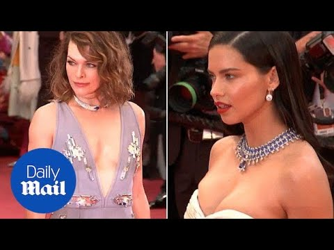 Adriana Lima and Milla Jovovich rock plunging necklines at Cannes - Daily Mail