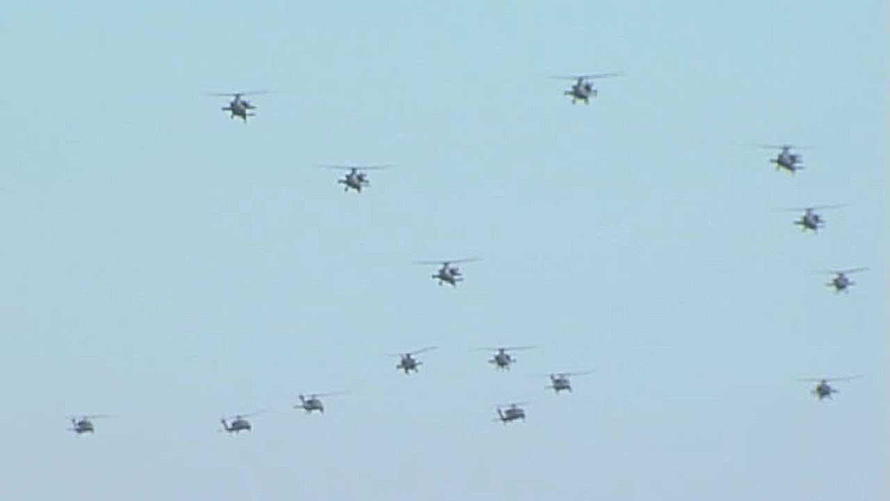 hight resolution of massive formation of ah 64 apache uh 60 black hawk helicopters arrive at jblm