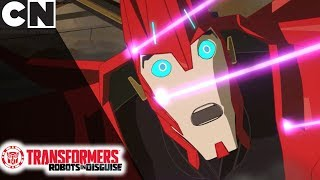 Transformers: Robots in Disguise | Struggling to Escape from the Base | Cartoon Network