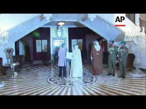 Bahrain's King Hamad greets UK PM in Manama