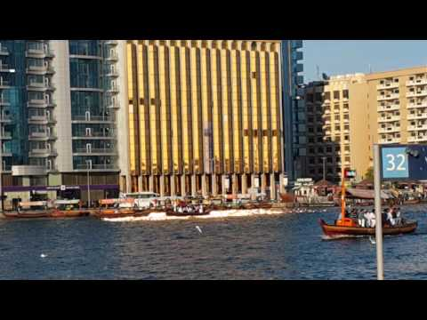 Emirates Bank Golden windows reflecting the gold colour on Dubai Creek