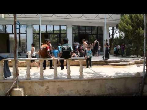 Qasioun News: Rif Dimashq: Entertainment trip for orphans in one of Ghouta Sharkia pools 2-8-2015