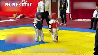 Boy goes viral for hugging and comforting his component during a toddler Taekwondo contest