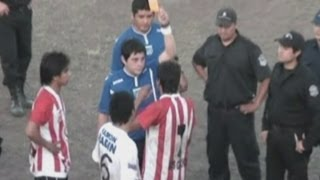 Footballer sent off for throwing dog against a fence in Argentina