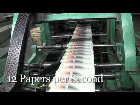 Newspaper printing press at work
