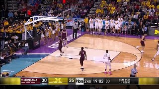 Charles Matthews leads Michigan with 20 points against Montana