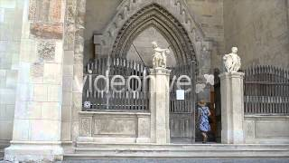 Young Woman Walks into Gothic Church