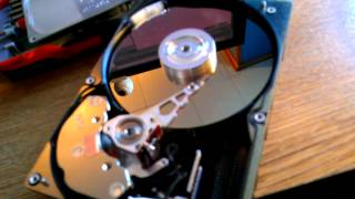 Seagate ST19101W 10k RPM SCSI hard drive 8GB running without its cover