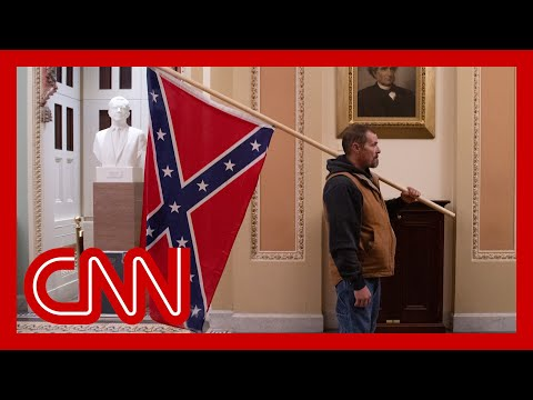 Man with Confederate flag in Capitol identified and arrested