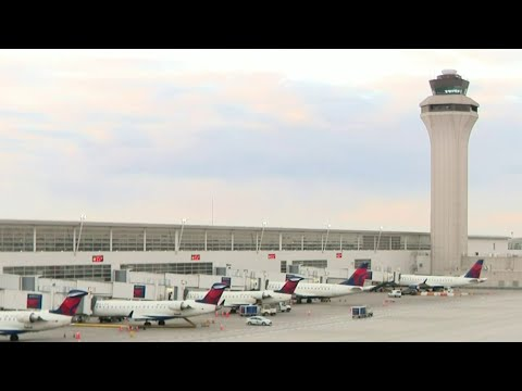 Woman tries to open emergency exit during flight headed to Detroit Metro Airport