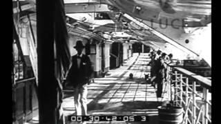 Giornale luce b0148 del 07/10/1932descrizione sequenze:porto ; transatlantico, prua, fiancata, ponte della nave, ciminiere turisti, marinai e operai sul po...