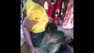 woman caught and naked for stealing bag of clothes in abidjan market