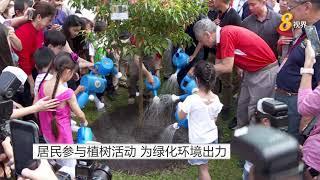 居民参与植树活动 为绿化环境出力