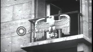 Nazi eagles on shattered windows of a government building in Berlin, Germany afte...HD Stock Footage