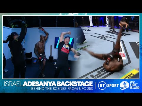 Israel Adesanya break dances next to Paulo Costa and then go