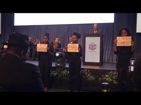 Four women stage a silent protest during president Jacob Zuma's speech at the ROC