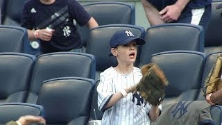 a young fan makes a great catch on foul ball