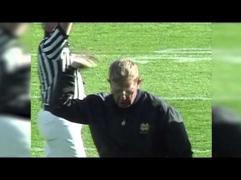 Lou Holtz puts a referee in a headlock