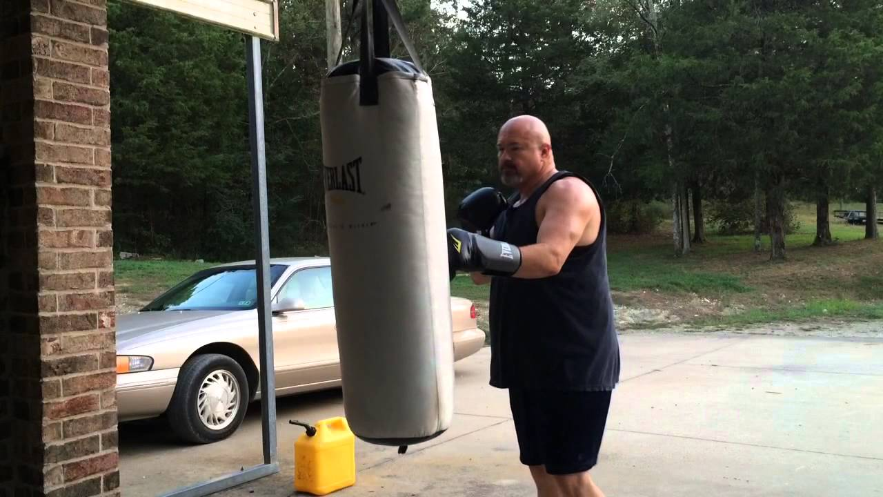 Fat Guy Boxing Working The Heavy Bag