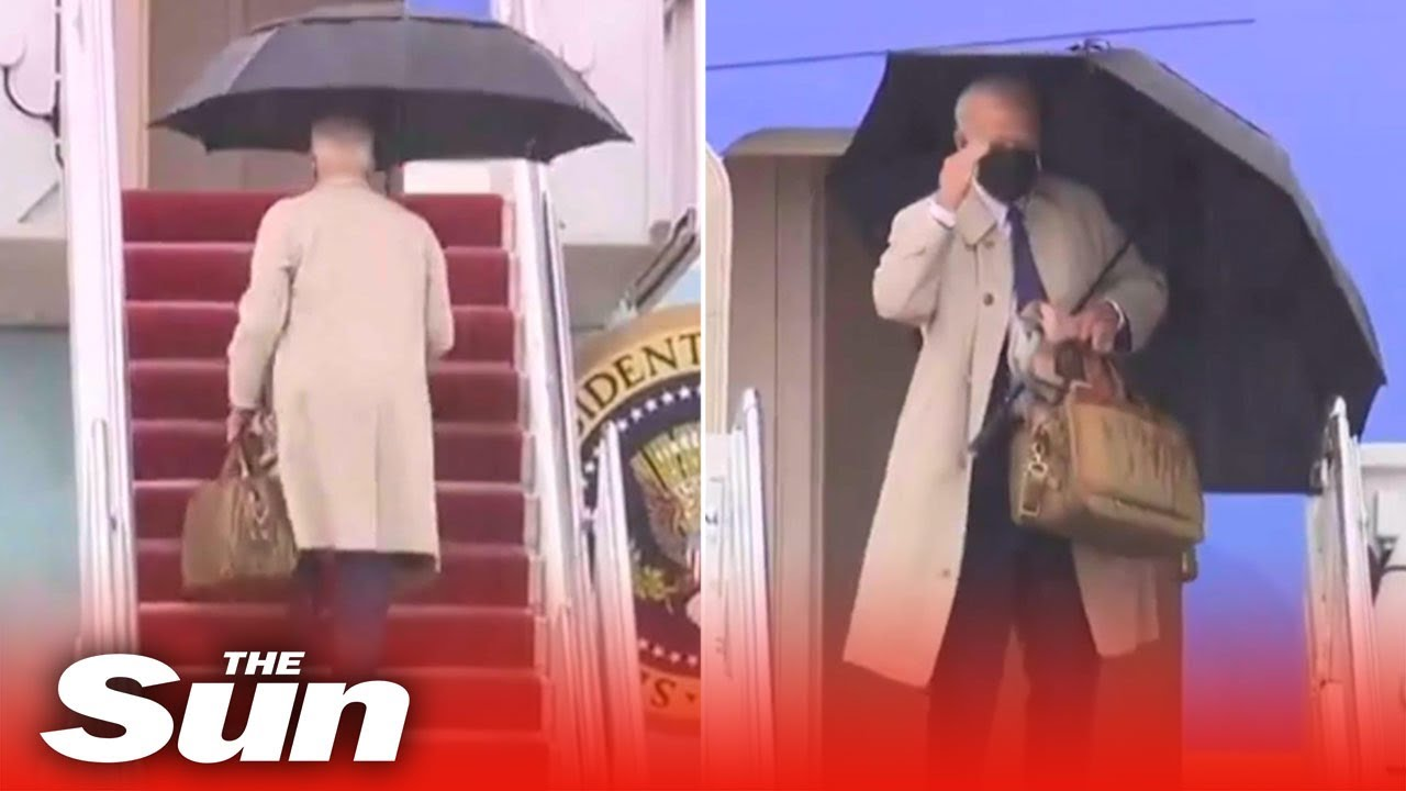 Joe Biden stumbles and almost falls over AGAIN while boarding Air Force One two weeks after slip-up