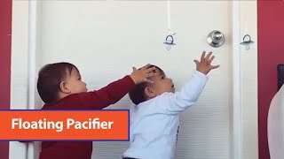 Adorable Babies Grab Pacifier Hanging From Balloon