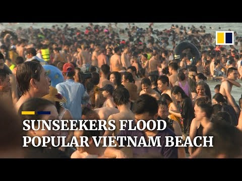 Thousands of weekend day trippers pack Sam Son beach in northern Vietnam