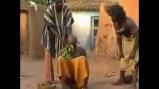 African Voodoo Witchdoctor Treats Man for Migraine