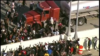 UPDATE: Semi truck drives through crowd of protesters, driver arrested
