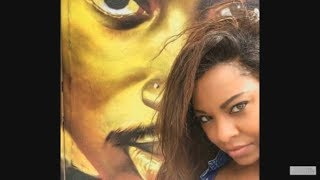 Ayanna Jackson [2Pac alleged rape victim] takes a picture in front of his mural