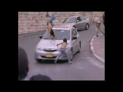 Israeli Colonist hitting two Palestinian children In Jerusalem (AL Quds) in Palestine