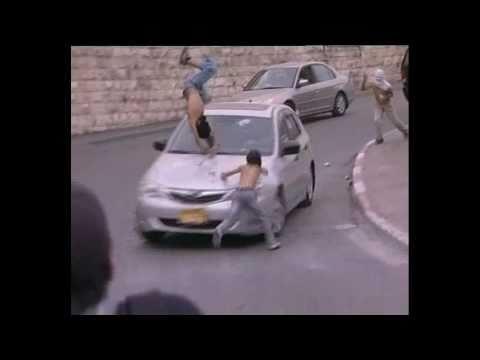 Israeli Colonist hitting two Palestinian children In Jerusalem (AL Quds) in Palestine