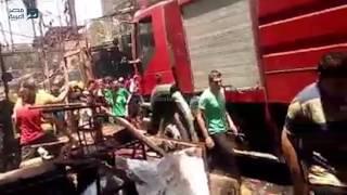 مصر العربية | الحماية المدنية تحاول السيطرة على حريق سوق الملابس بإمبابة