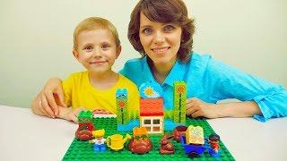 Лего огород и Даник с мамой. Собираем конструктор Lego Duplo мой первый сад. Видео детям(В этом детском видео мы вместе с Даником и его мамой будем играть с конструктором Лего Дупло мой первый..., 2016-07-28T11:19:51.000Z)