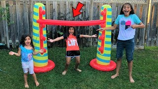 Kids playing Inflatable Limbo Challenge! family fun summer game