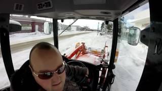 kioti ck 3510 snow clearing a parking lot