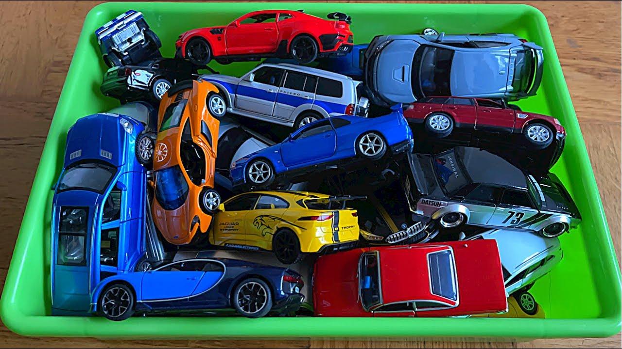 A green Box Full Of Various Diecast Model Cars