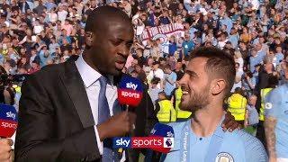 Yaya Toure interviews Bernardo Silva on the pitch after Man City win the Premier League
