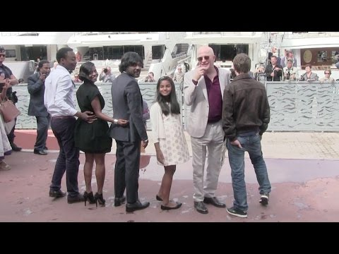 Director Gaspar Noe and his cast on the red carpet of Love in Cannes