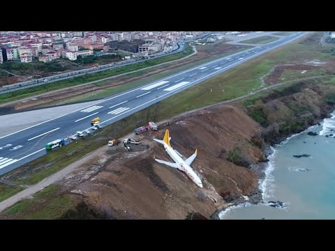 Footage shows plane stuck on cliff edge after skidding off runway in Turkey