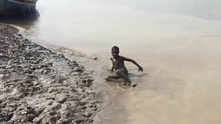Children Playing at the Bank of a River