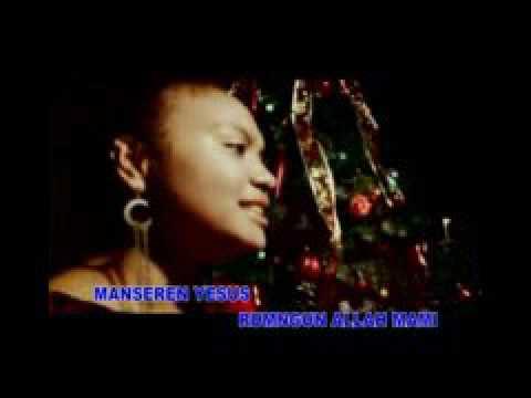 malam kudus bersi bahasa biak yang di nyanyikan oleh gadis papua