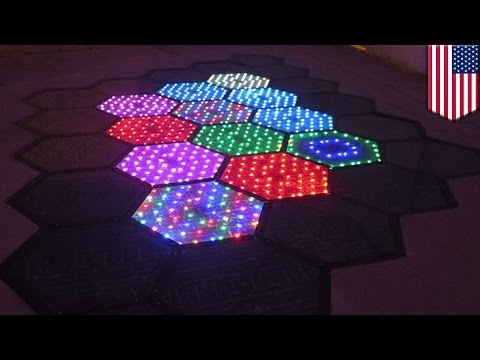 Solar powered road panels light up the streets, display signs on the road - TomoNews