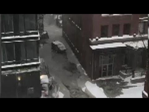 Dumpsters are floating down the street in downtown Boston, MA