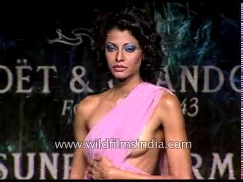 Indian women model sarees and designerwear at a Suneet Verma fashion show thumbnail