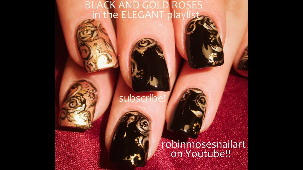 black and gold rose nail art design