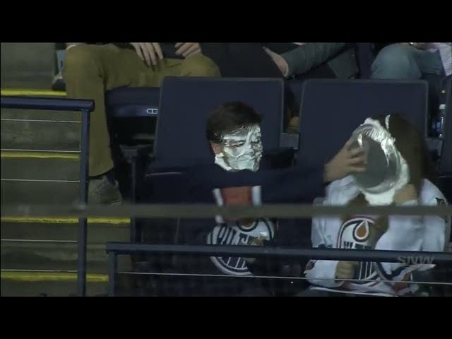 Edmonton Oilers fan gets pie in the face