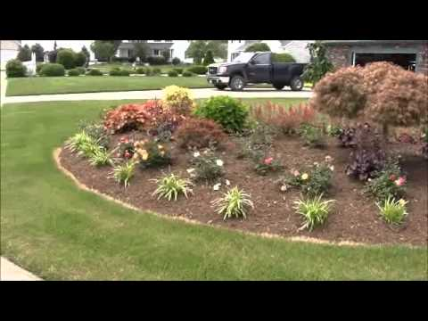 Landscaping ideas corner bed planting youtube for Show me garden designs